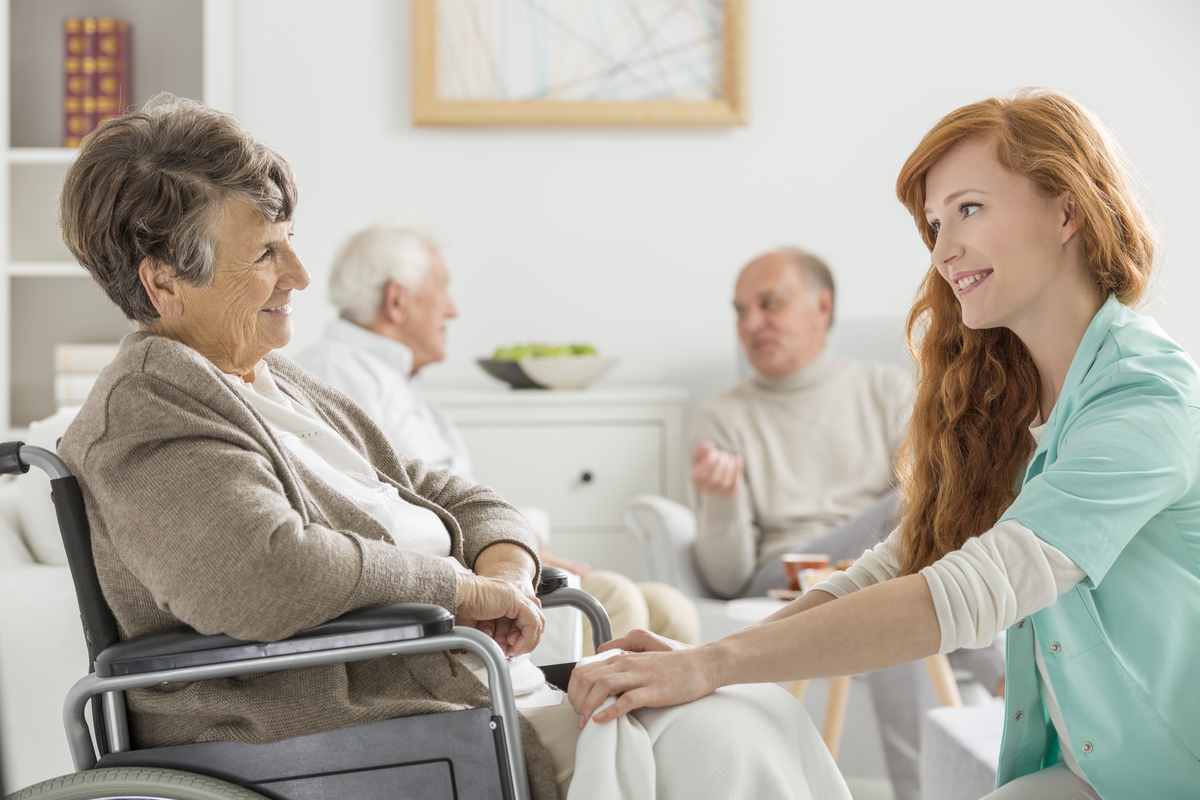 A senior and staff member at an assisted living facility.