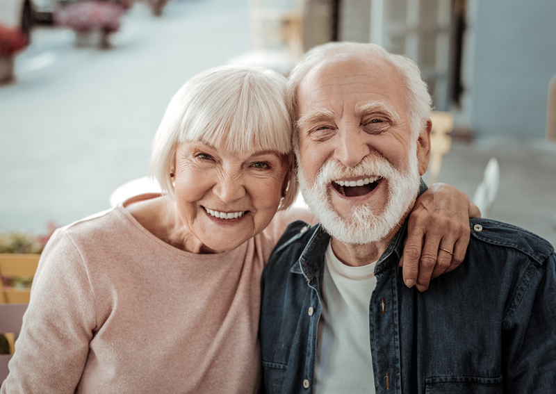 Two happy seniors in an assisted living home.