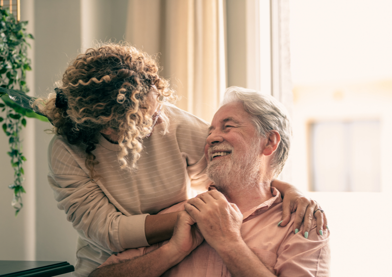 A man and woman at an assisted living home.