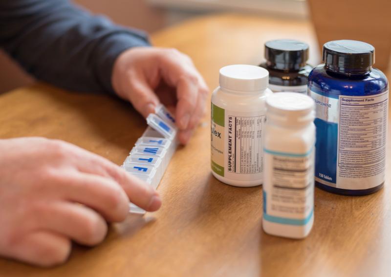 A caregiver managing medication for a senior.