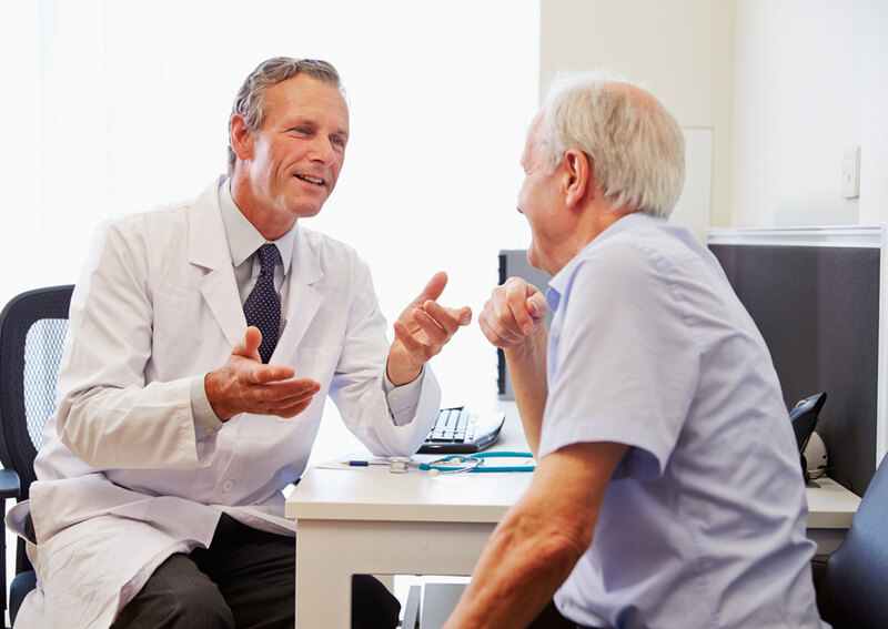 A doctor speaking to a senior