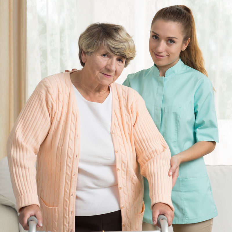 A nurse and a senior in a skilled nursing home.